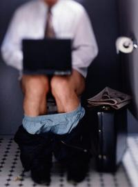 Man blogging on the toilet